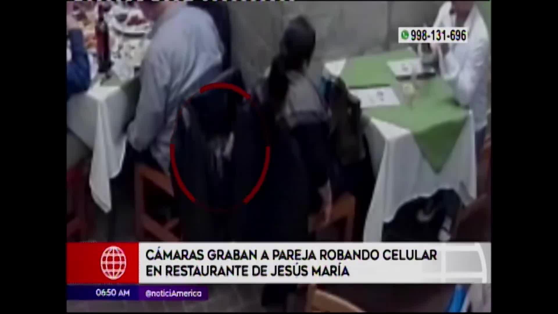 Jesús María: cámaras de seguridad captan a pareja robando celulares en restaurante