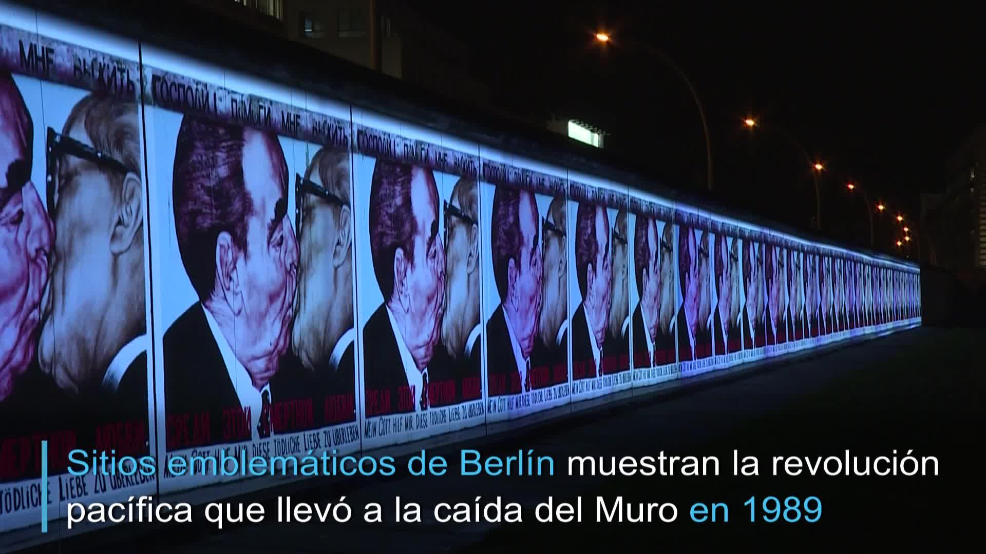 La caída del muro de Berlín se proyecta en paredes de la capital alemana